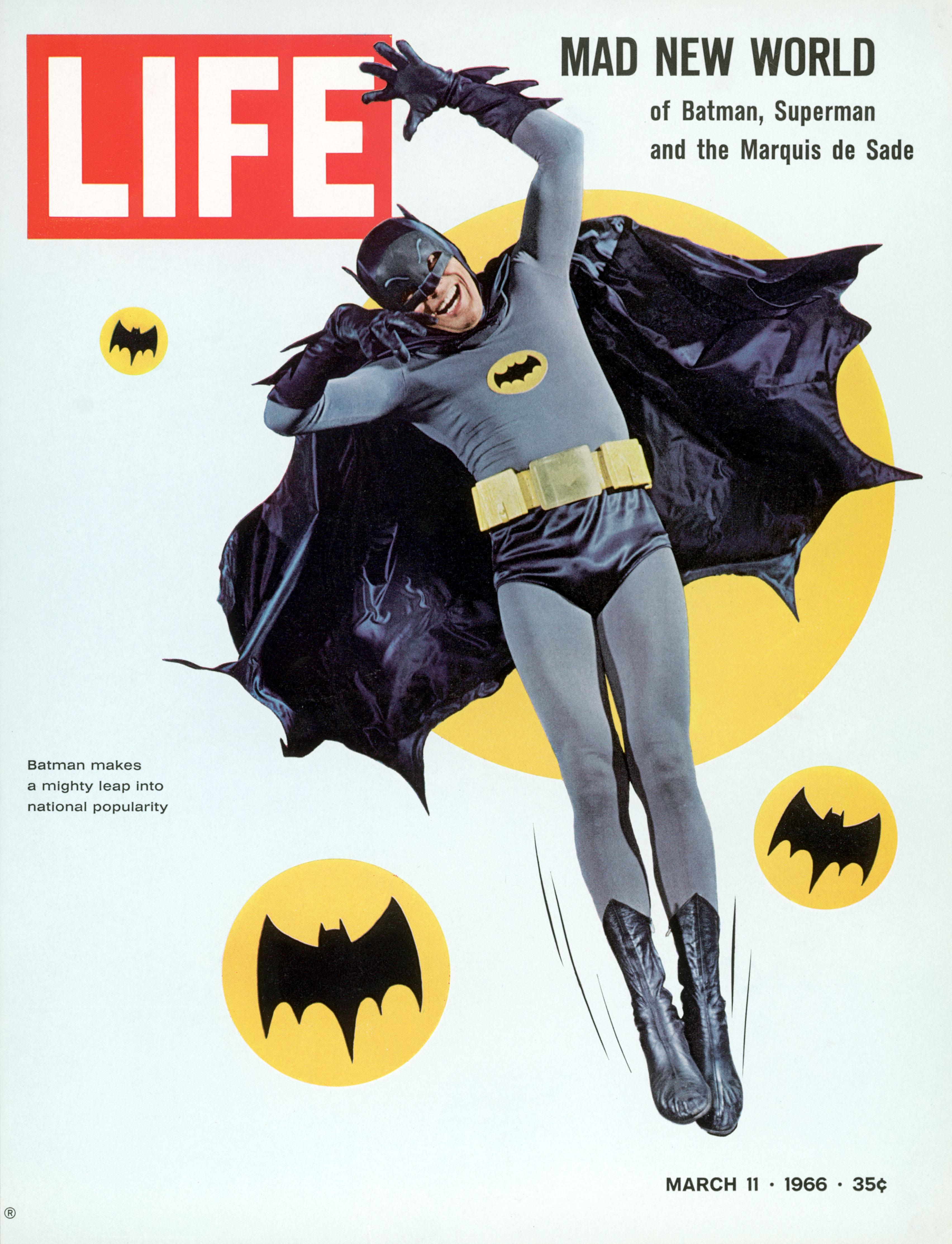 Adam West strikes a hammy pose as superhero Batman in 1966.