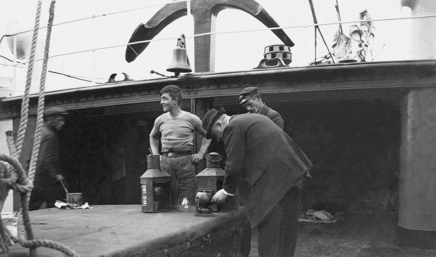 Inspection of signal lamps aboard a tender used to ferry passengers to the Titanic, 1912.