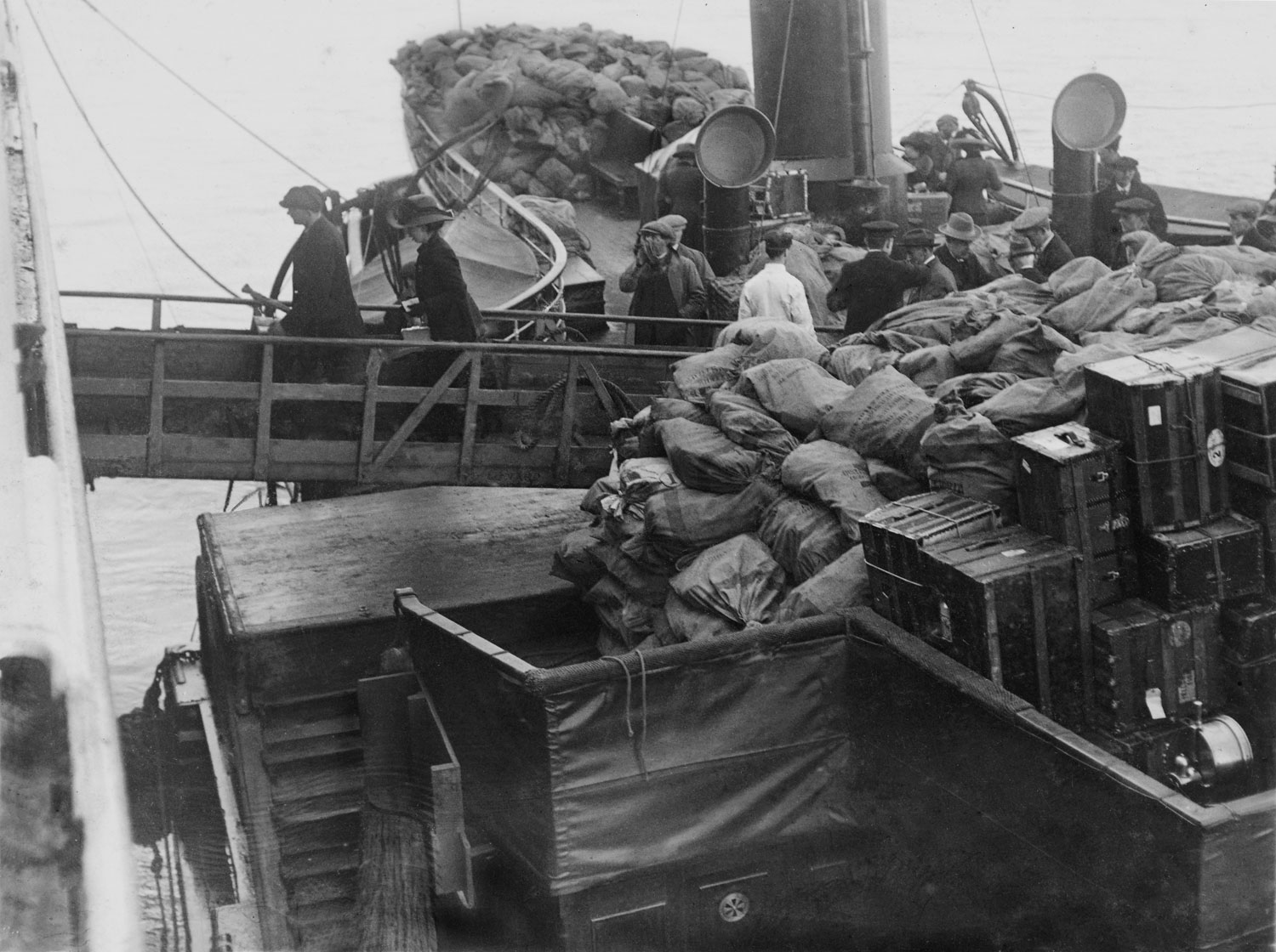 Mail bags and trunks being loaded onto the Titanic, April 11, 1912.