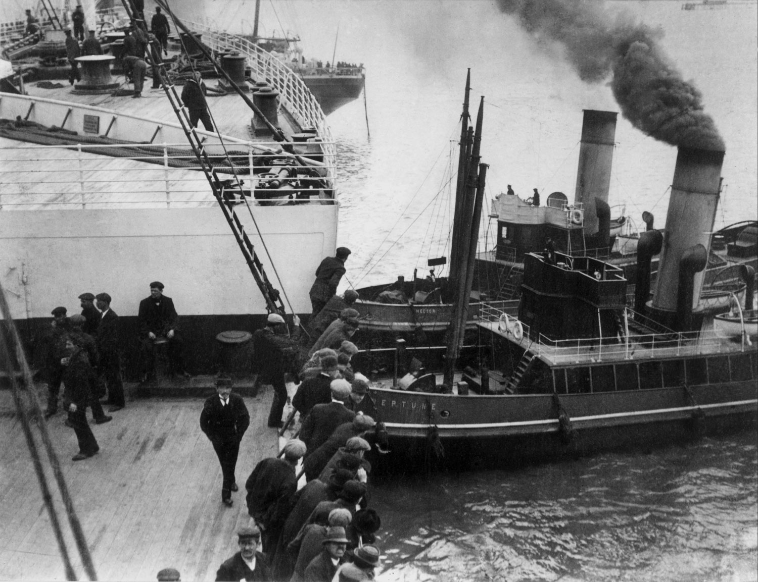Tugs 'Hector' and 'Neptune' nudging the bow of the Titanic away from a near collision, 1912.