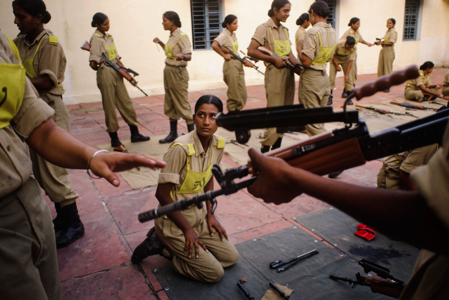 Scholarship winner Poulomi BasuWomen from the Indian Border Security Armed Force during a weapon-cleaning session in their training camp.