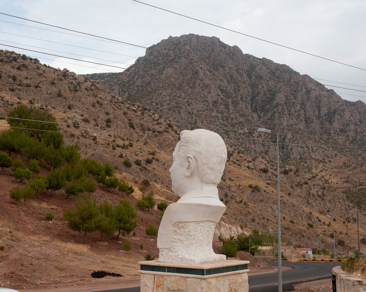 Donald Weber, War is Good*A statue of the famous Kurdish singer Tehsin Taha, from the town of Amedi. The statue was made post-Saddam, as Kurdish customs and culture were suppressed for many years.