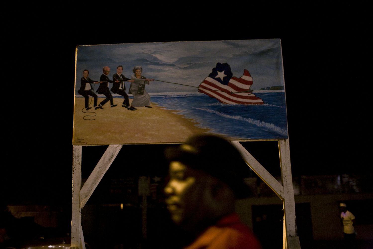 A signboard depicts President Ellen Johnson Sirleaf helping to save Liberia.
