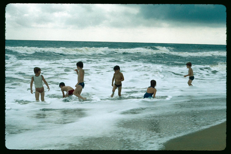 Jeff with friends at Little Bassa Beach. 1977.
