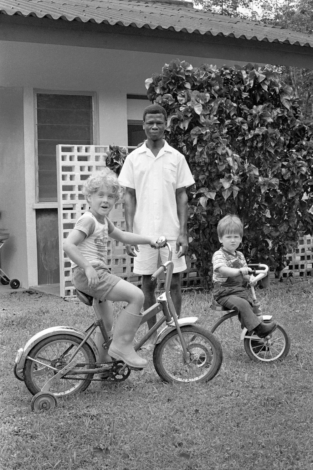 The Tophams' housekeeper James Morris on the front yard. The brothers' journey to find out what happened to him is how Liberia 77 began. On the Exchem Compound, 1977.