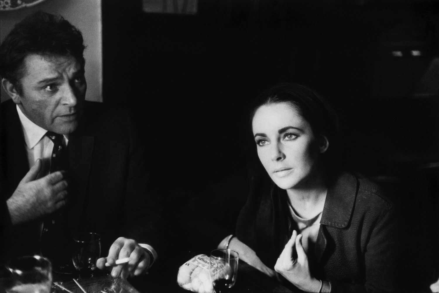 Richard Burton and Elizabeth Taylor at the local pub in Shepperton, England, where he is starring in the role of Becket.