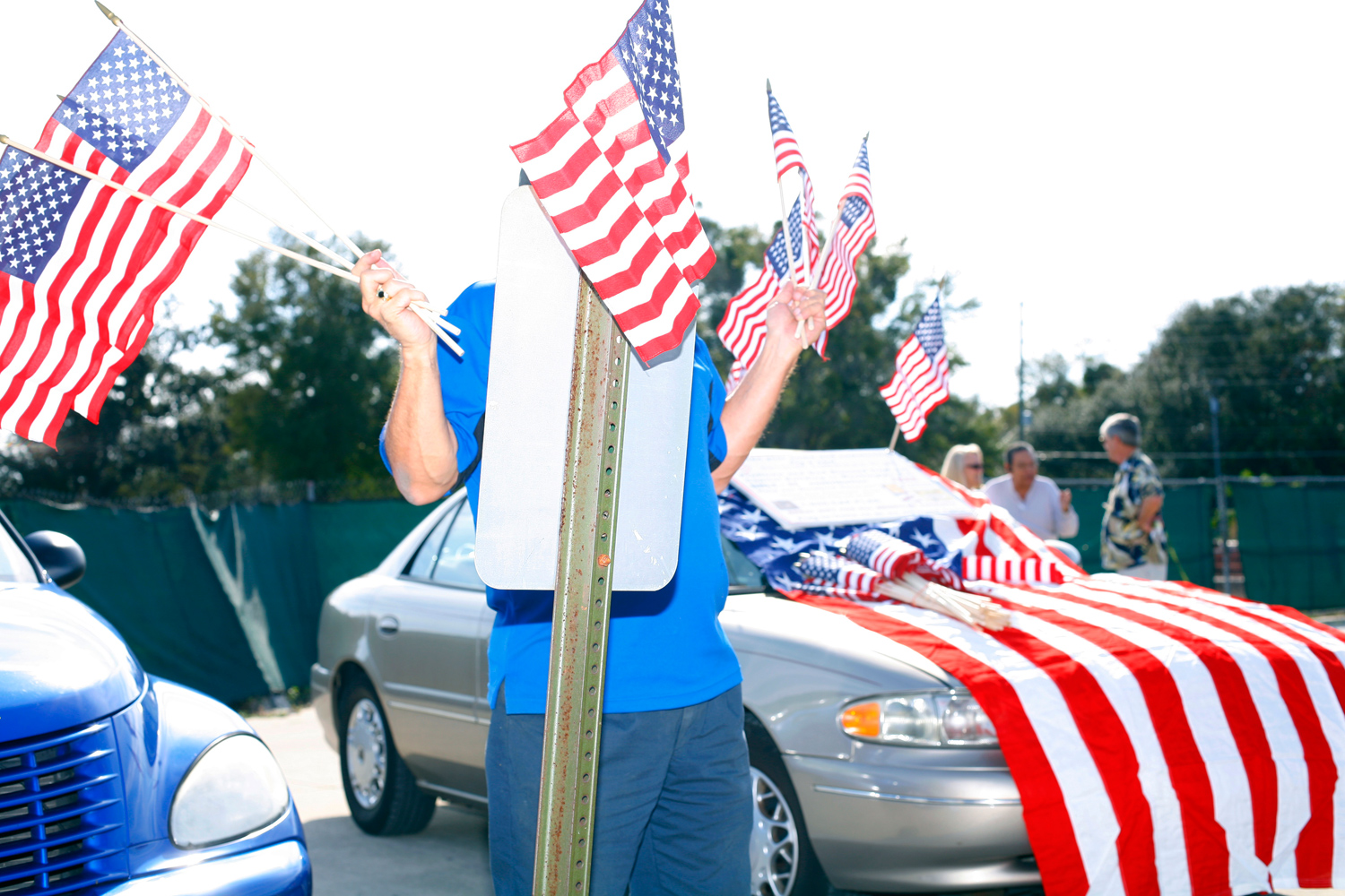 A man sells flags outside a Gingrich rally at the Centro de Familia, Orlando, Fla., January 28, 2012.