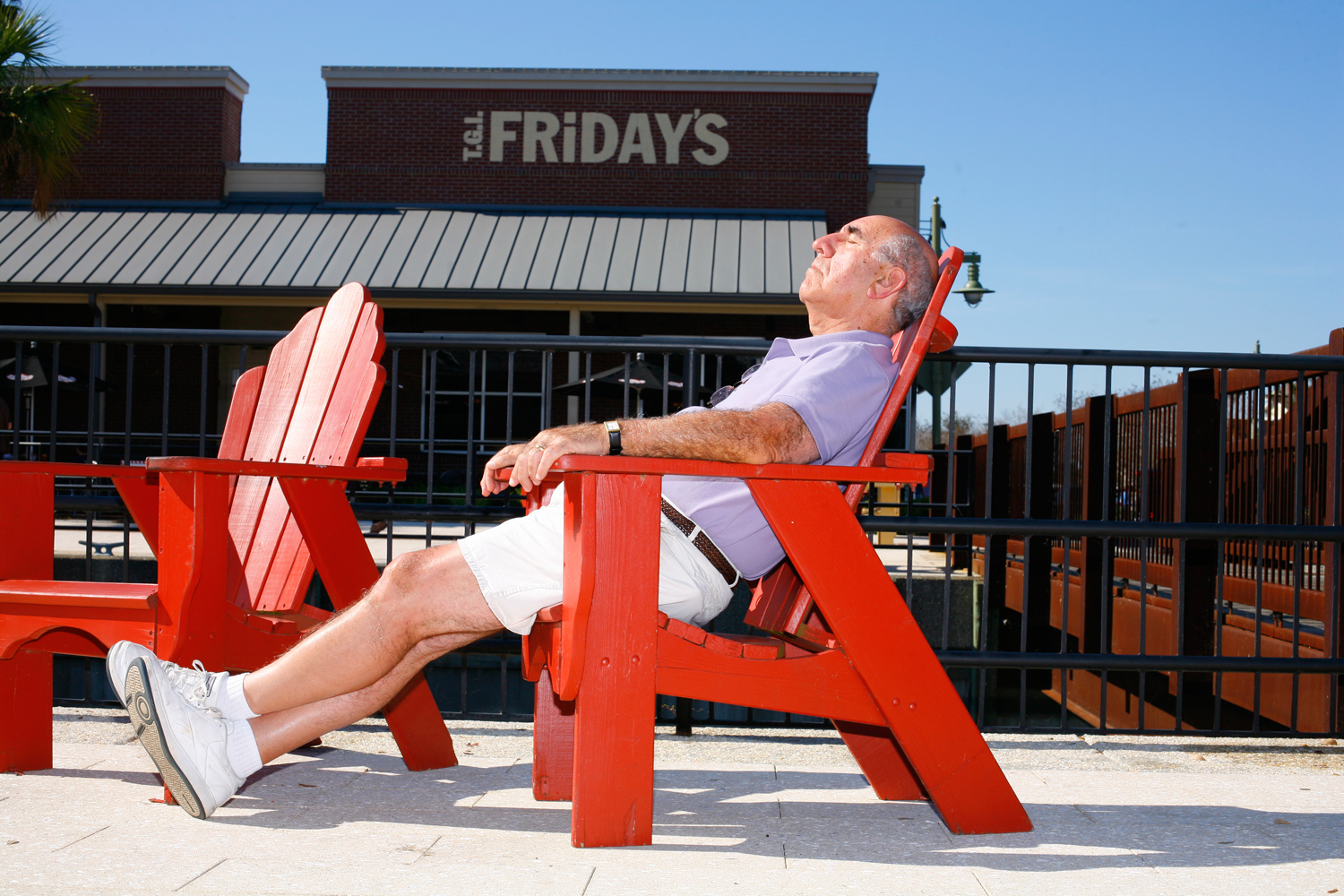 A man relaxing outside a T.G.I. Friday's at the Villages, Fla., January 29, 2012.