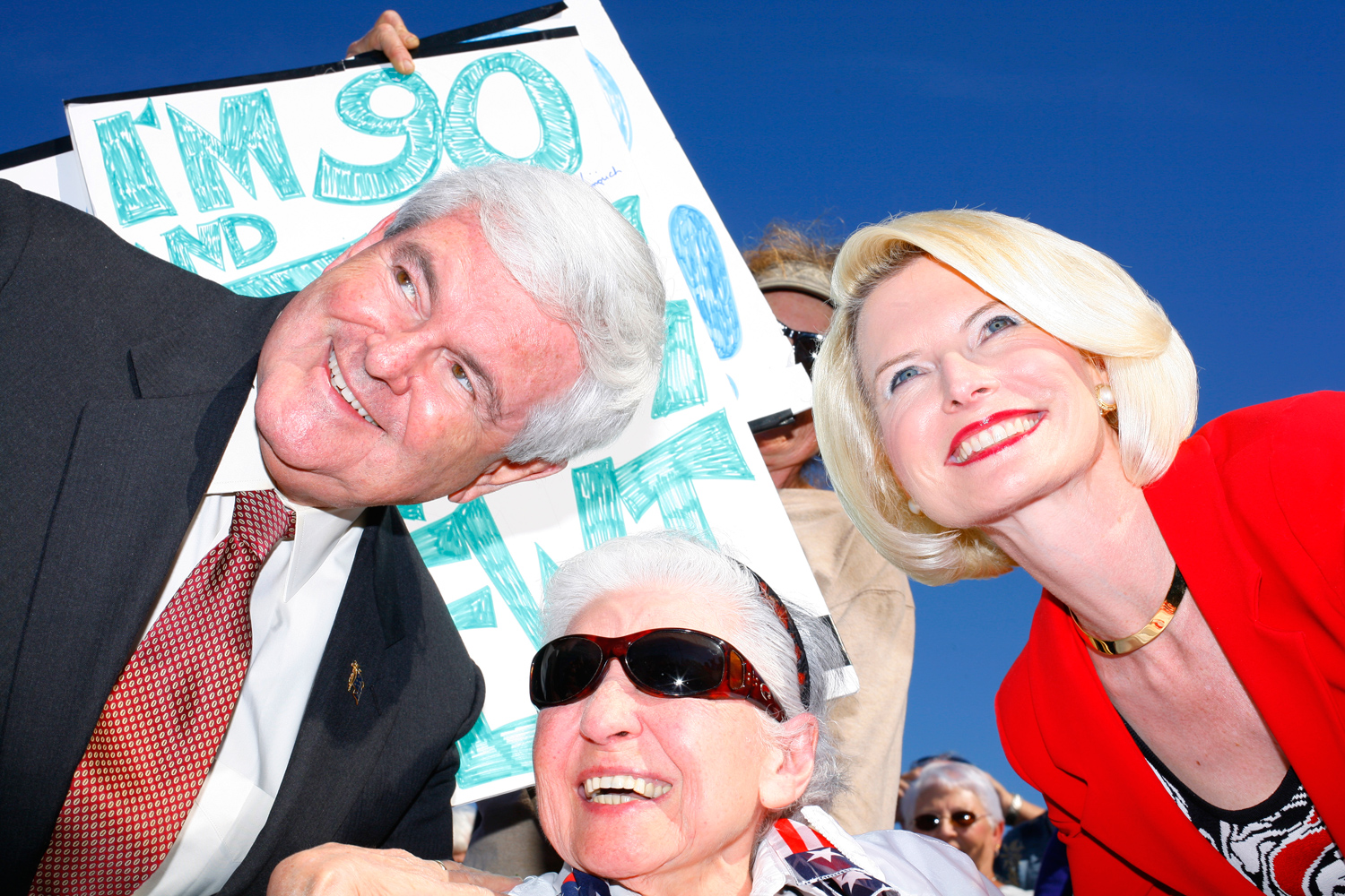 Newt and Callista Gingrich pose for photos during a rally at The Villages, Fla., January 29, 2012.
