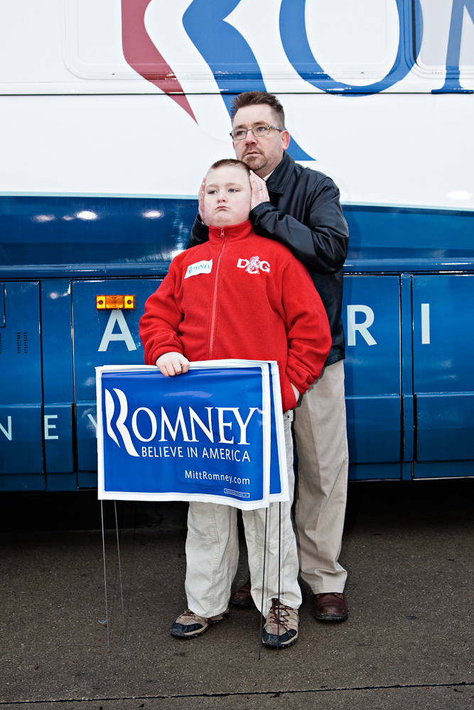 Dan Lindsay and his 10-year-old son Tyler at a Romney event at the Hy-Vee parking lot in West Des Moines, Iowa on December 30, 2011.