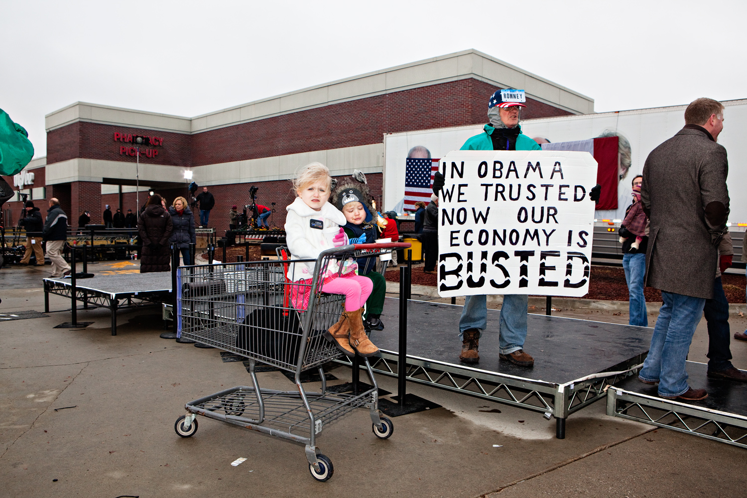 John Strong, a U.S. veteran and Mitt Romney supporter, holds an anti-Obama sign at a campaign event at the Hy-Vee in West Des Moines, Iowa on December 30, 2011.