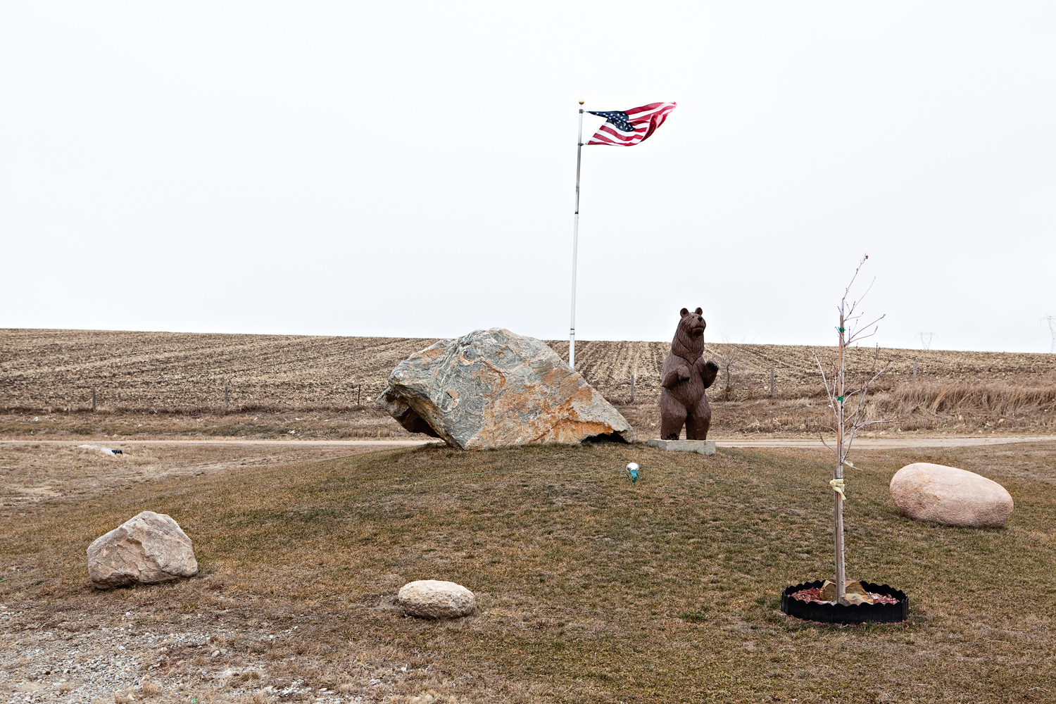 A flag flies over the landscape of Walford, Iowa on January 2, 2012.