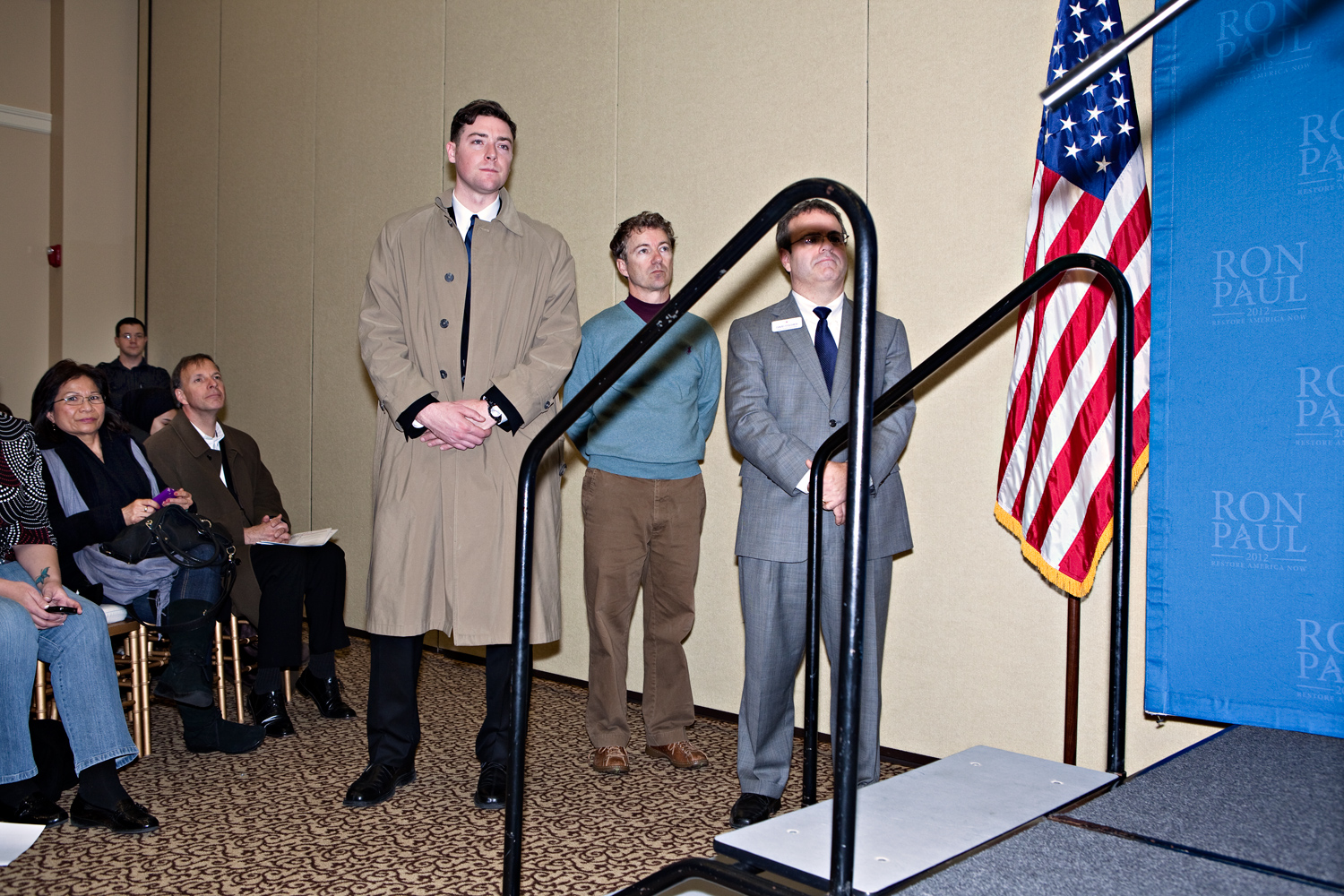 Rand Paul (center) listens to his father Ron Paul at a campaign event in Cedar Falls, Iowa on January 2, 2012.