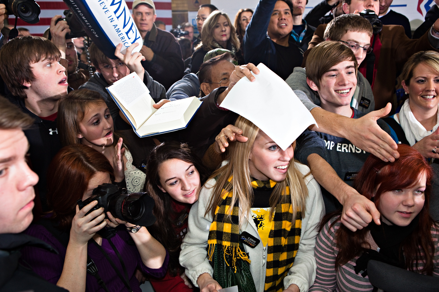 Young Romney supporters swarm to meet him for autographs at a campaign stop in Clive, Iowa on January 2, 2012.