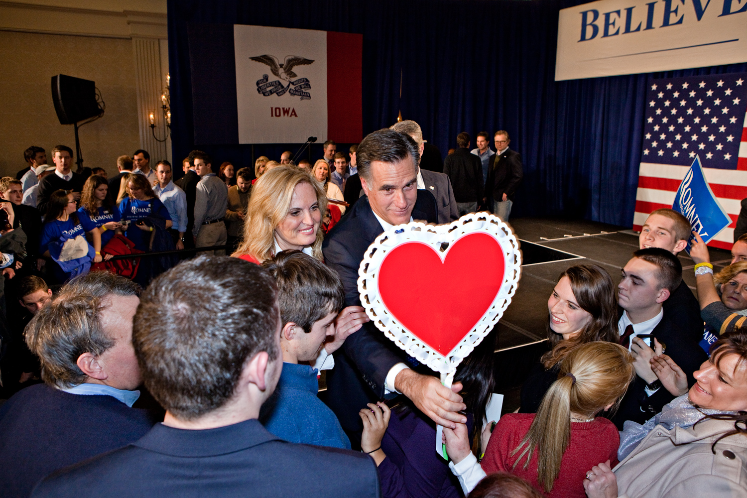 Republican presidential candidate Mitt Romney and his wife Ann are greeted with a gift from a supporter at his Iowa Caucus night rally in Des Moines, Iowa, January 3, 2012.