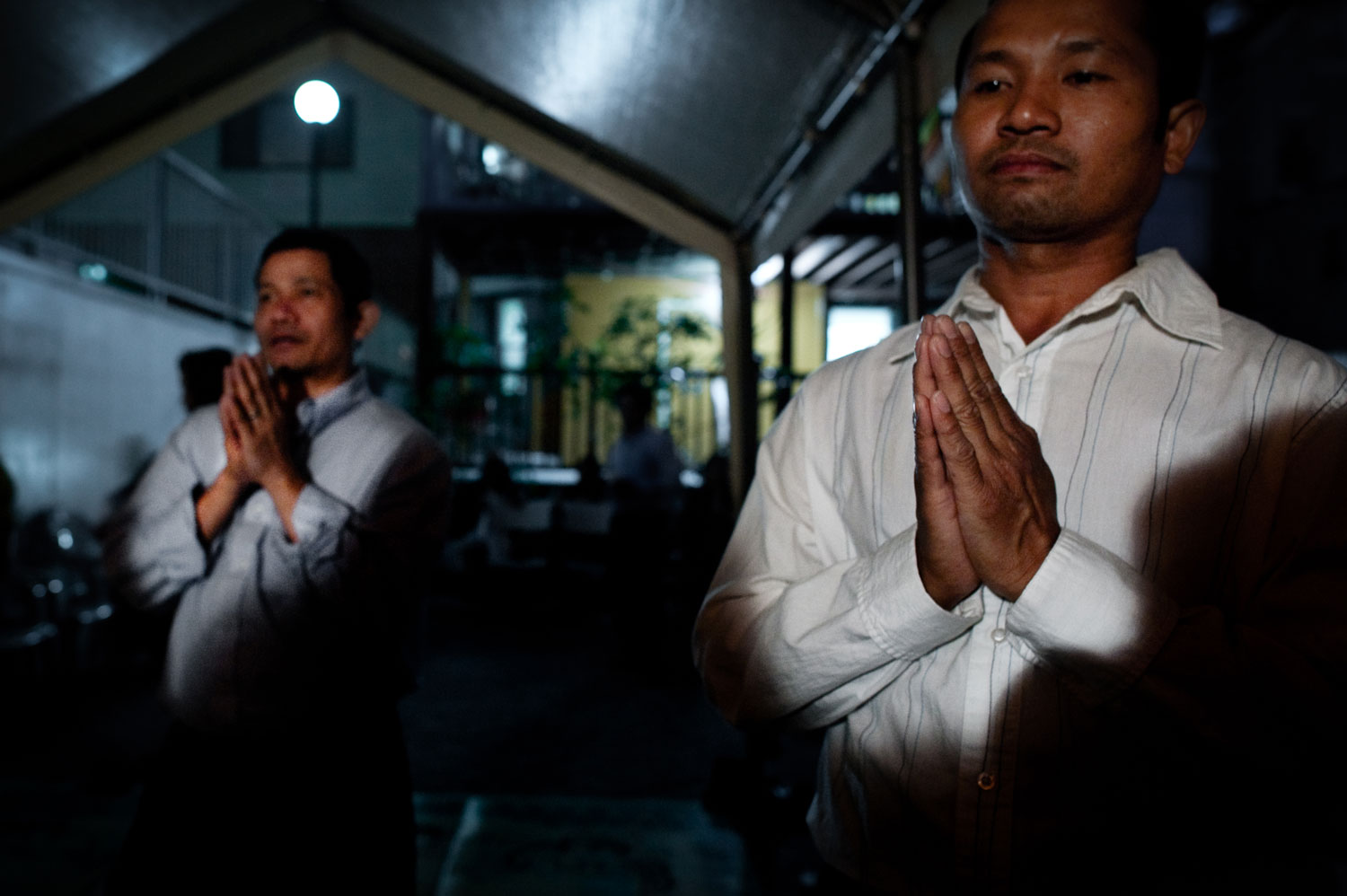 Bronx, New York City, August 2011.Men worship at a ceremony in the Bronx temple.