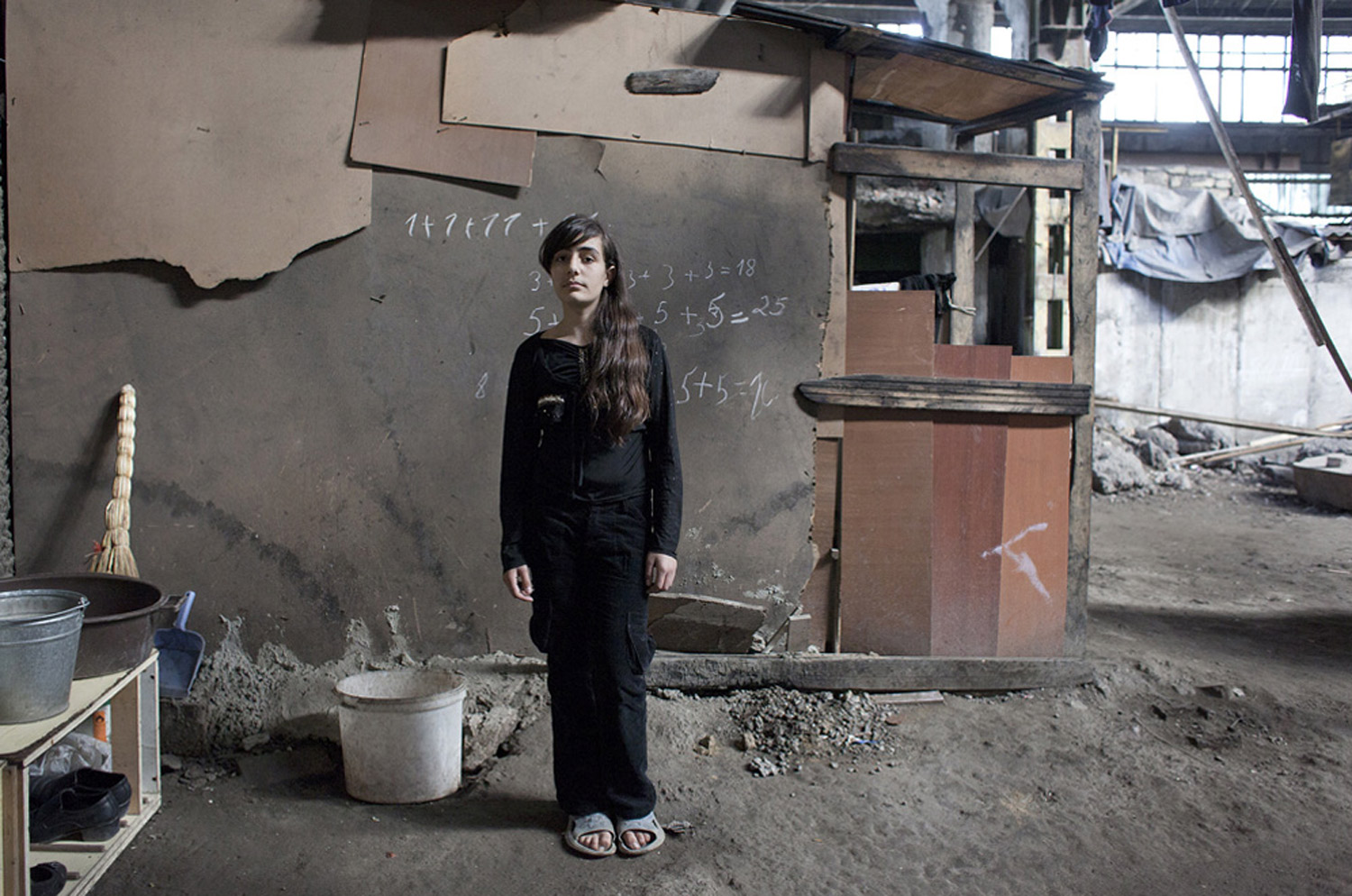 Sona poses for a photograph in a refugee settlement in Azerbaijan, 2010.