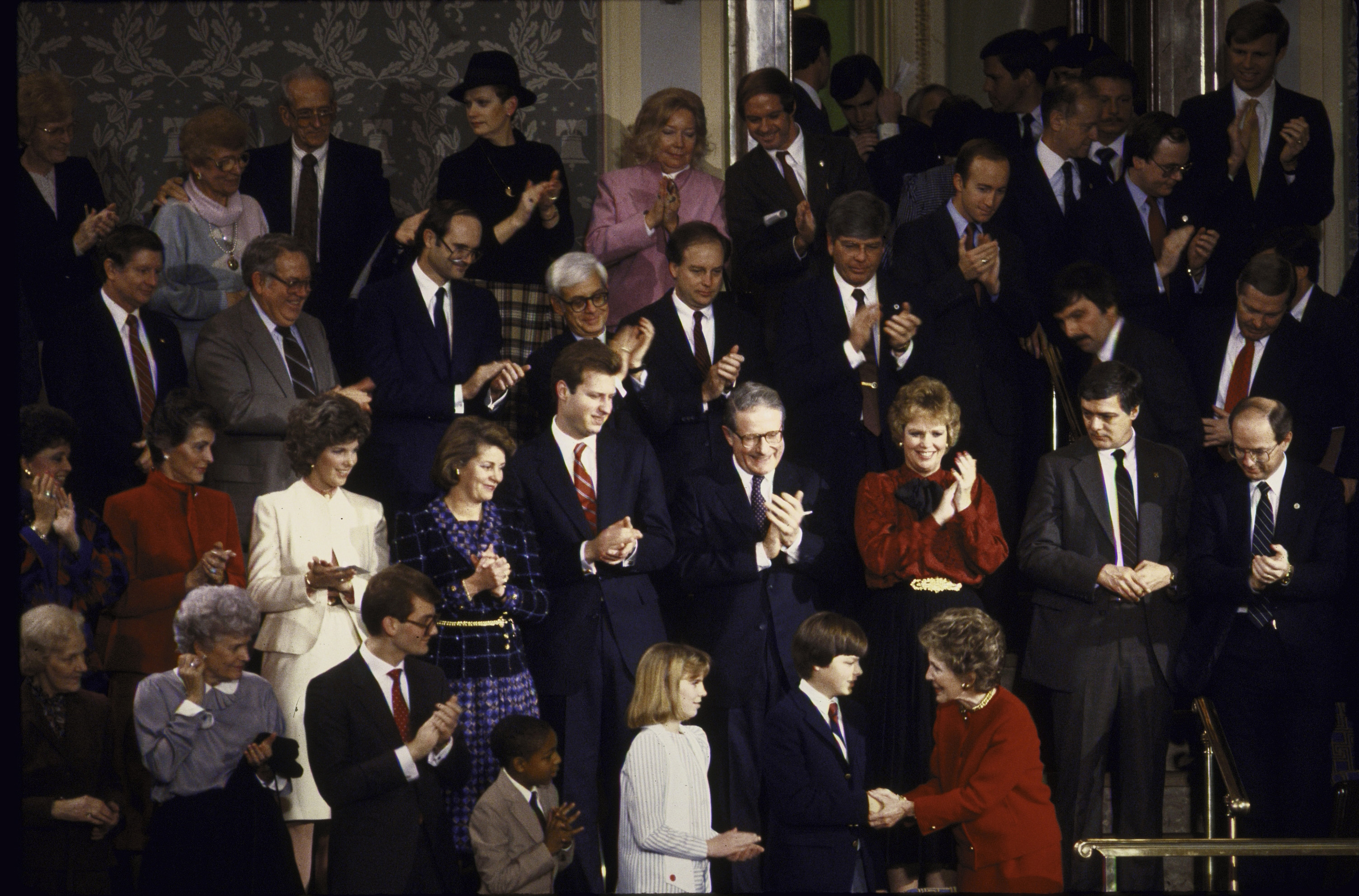 Nancy Reagan attends the State of the Union Address with Trevor Ferrell, Richard Cavioli, Shelby Butler and Tyrone Ford on Feb. 2, 1986.   With the help of his family and local churches, 13-year-old Ferrell delivered food and blankets to the homeless in Philadelphia.