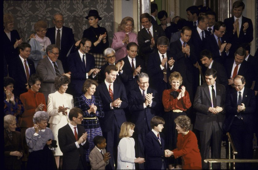 First Lady Nancy Reagan (front in red dress) at Reagan's