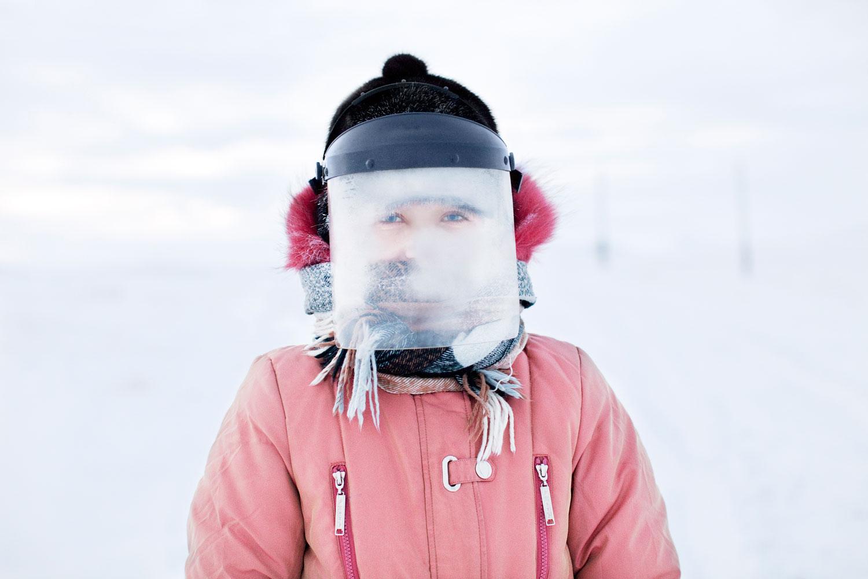 Evgenia Arbugaeva, Tiksi, the Far NorthAstronaut on Neptune, or Tanya wears snow mask.January 2011.