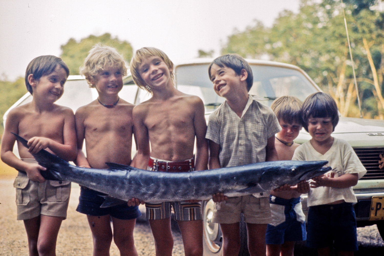 Canadian kids with barracuda. Exchem Compound, 1978.