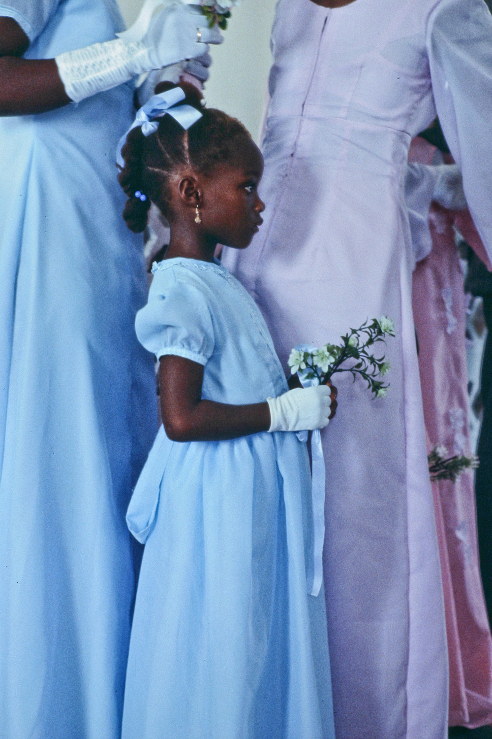Flower girl at George Gould's wedding (Exchem Driver). Monrovia, 1979.