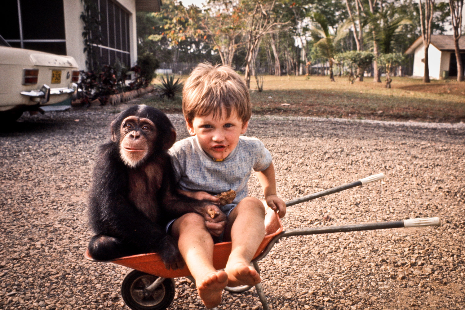 Andrew with Evelyn in the driveway. Exchem Compound, 1978.