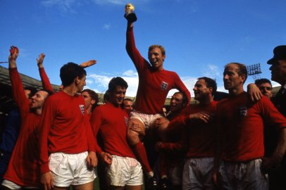 Bobby Moore raises the World Cup trophy, July 30, 1966, after England defeated Germany, 4-2, in the final before 98,000 fans at Wembley Stadium, London.