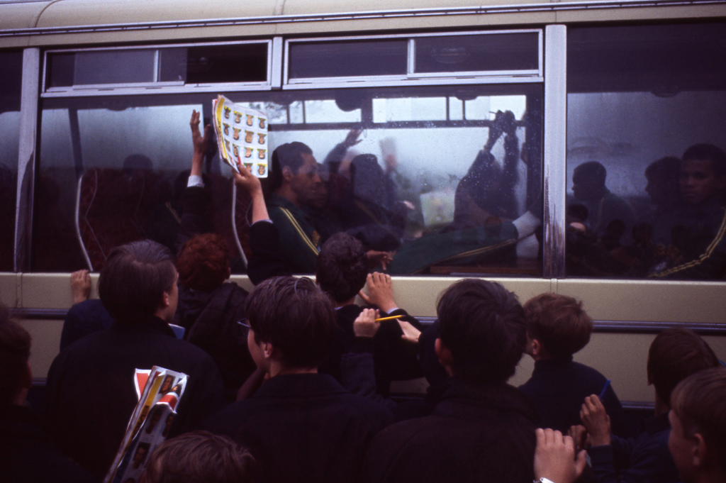 <strong>Not published in LIFE.</strong> English fans happily swarm around the Brazilian squad's bus, 1966.