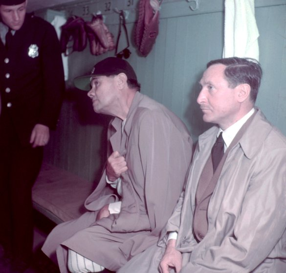 Babe Ruth and two unidentified men in the locker room at Yankee Stadium, June 13, 1948.
