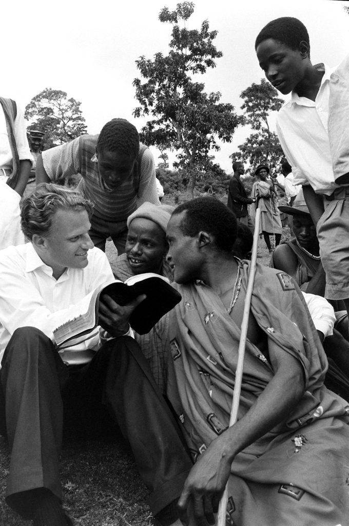 <strong>Not published in LIFE.</strong> During his 1960 African crusade, Graham explained the Bible to a group of Waarusha warriors living in a village at the base of Mount Meru, not far from Kilimanjaro, in Tanganyika (now Tanzania).