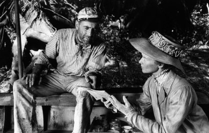 "Humphrey Bogart and Katharine Hepburn on location in Africa for the filming of ""The African Queen,"" 1951."