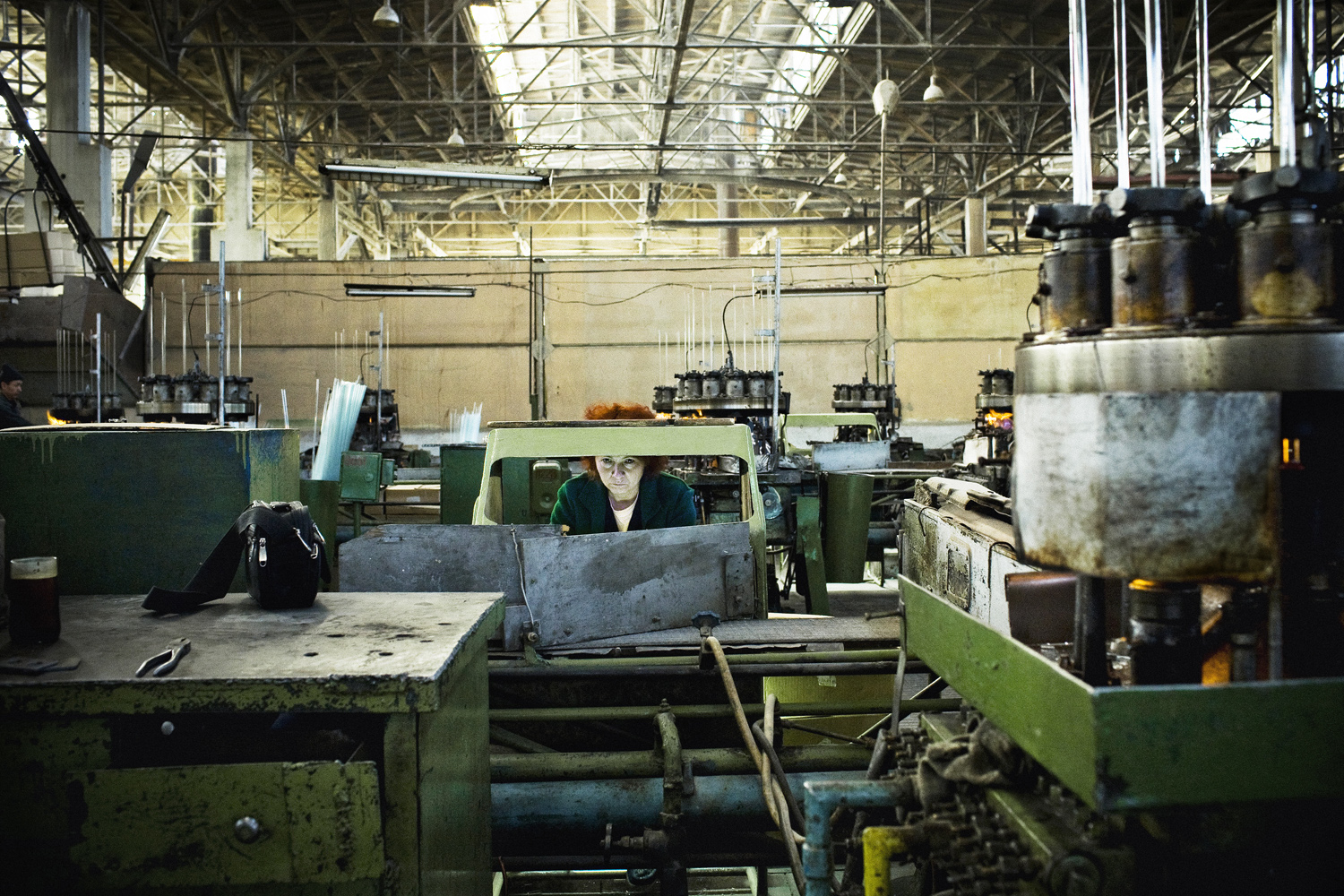 2008. A woman works at the Mailuu Suu factory in the Djalalabad region. During Soviet times, most of the electric lightbulbs in the USSR were made here. Today, only one third of the factory is still working and many workers haven't been paid for months.