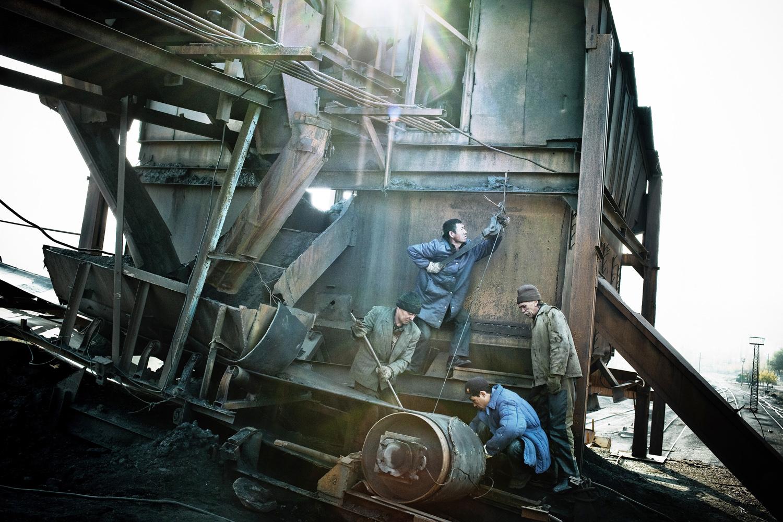 2008. Outside of Bishkek, men try to repair an old Soviet-era coal plant.