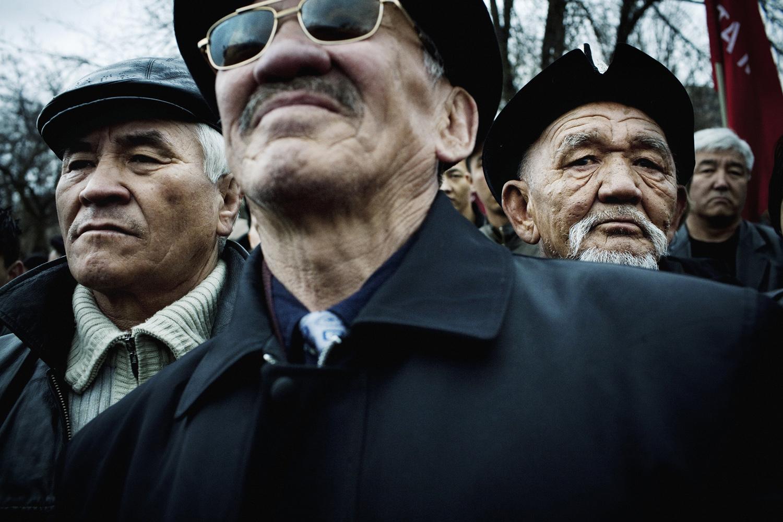 2009. Men take part in a demonstration against President Bakiyev in Bishkek.