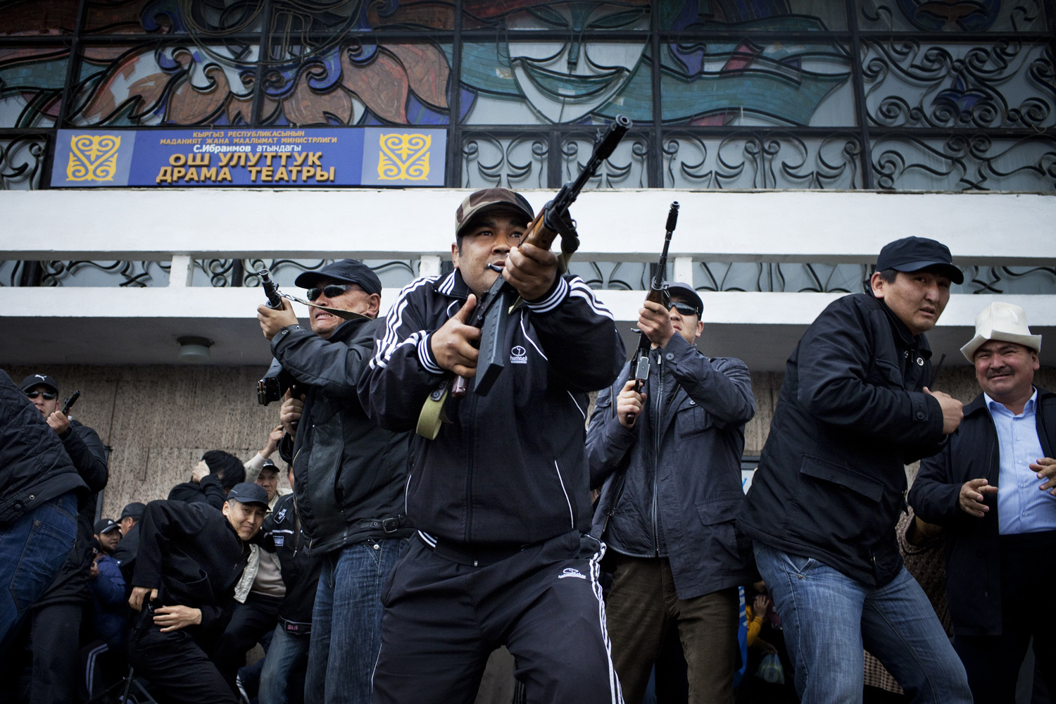 2010. The personal bodyguards of toppled President Bakiyev shoot into the air in an attempt to calm down anti-Bakiyev demonstrators in Osh, in April 2010. Bakiyev later escaped the city and flew to Kazakhstan.