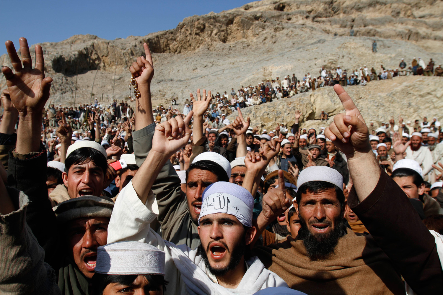 Feb. 24, 2012. Afghans shout slogans during an anti-U.S. protest over the burning of Korans at a military bass in Afghanistan, in Ghani Khail, east of Kabul.
