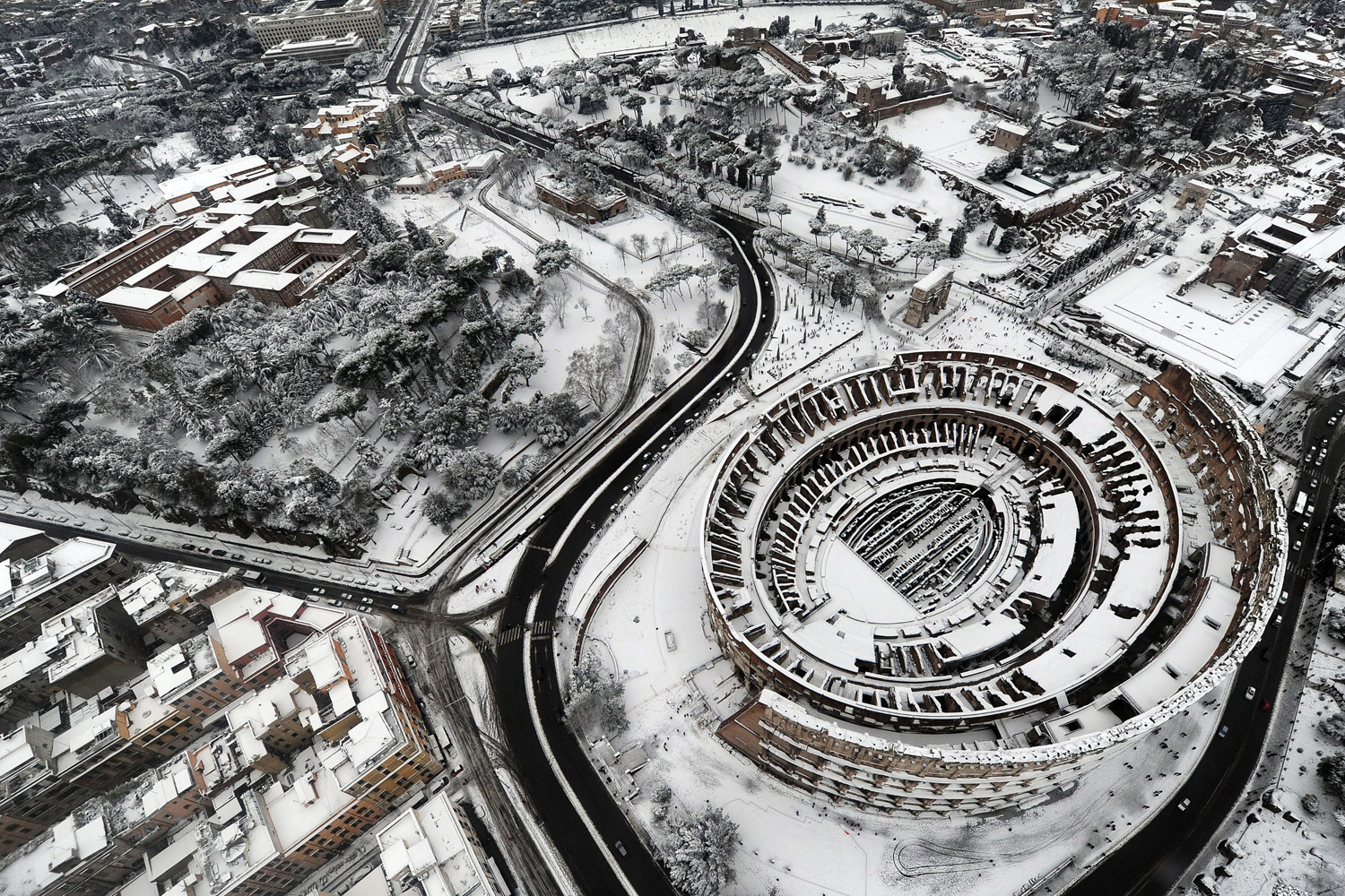February 4, 2012. An aerial view showing the Colosseum in Rome following heavy overnight snowfall.