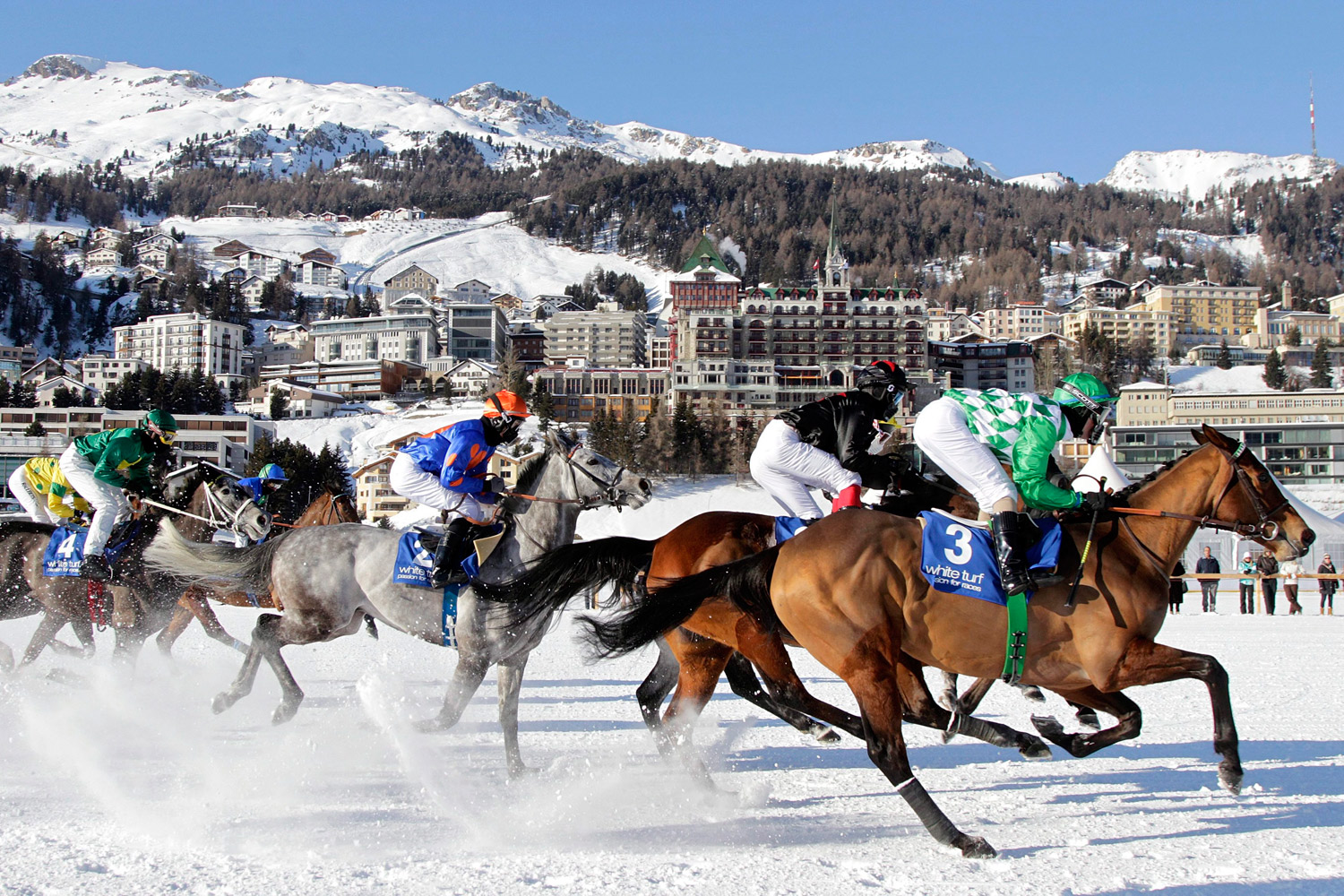 February 5, 2012. Riders and horses compete during the Grand Prix American Airlines on the frozen Lake on the first weekend of the White Turf races in St. Moritz, Switzerland.