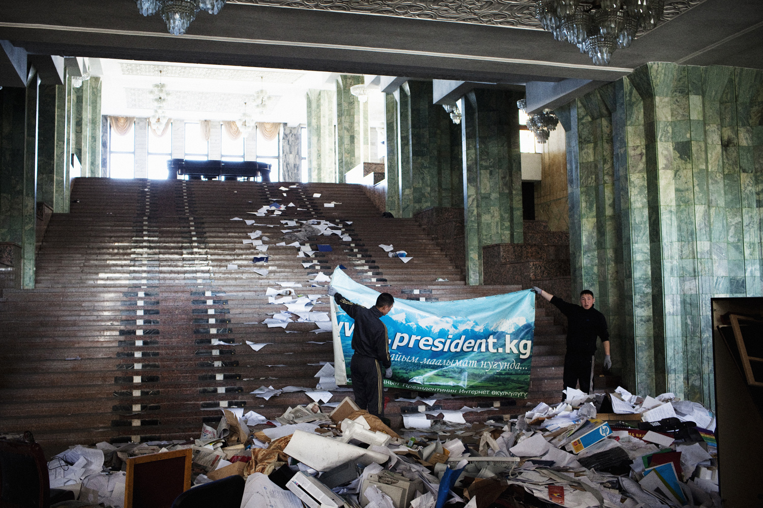 2010. Men clean up the White House in Bishkek following the April uprising, during which President Bakiyev was overthrown and the presidential palace was looted and set on fire.