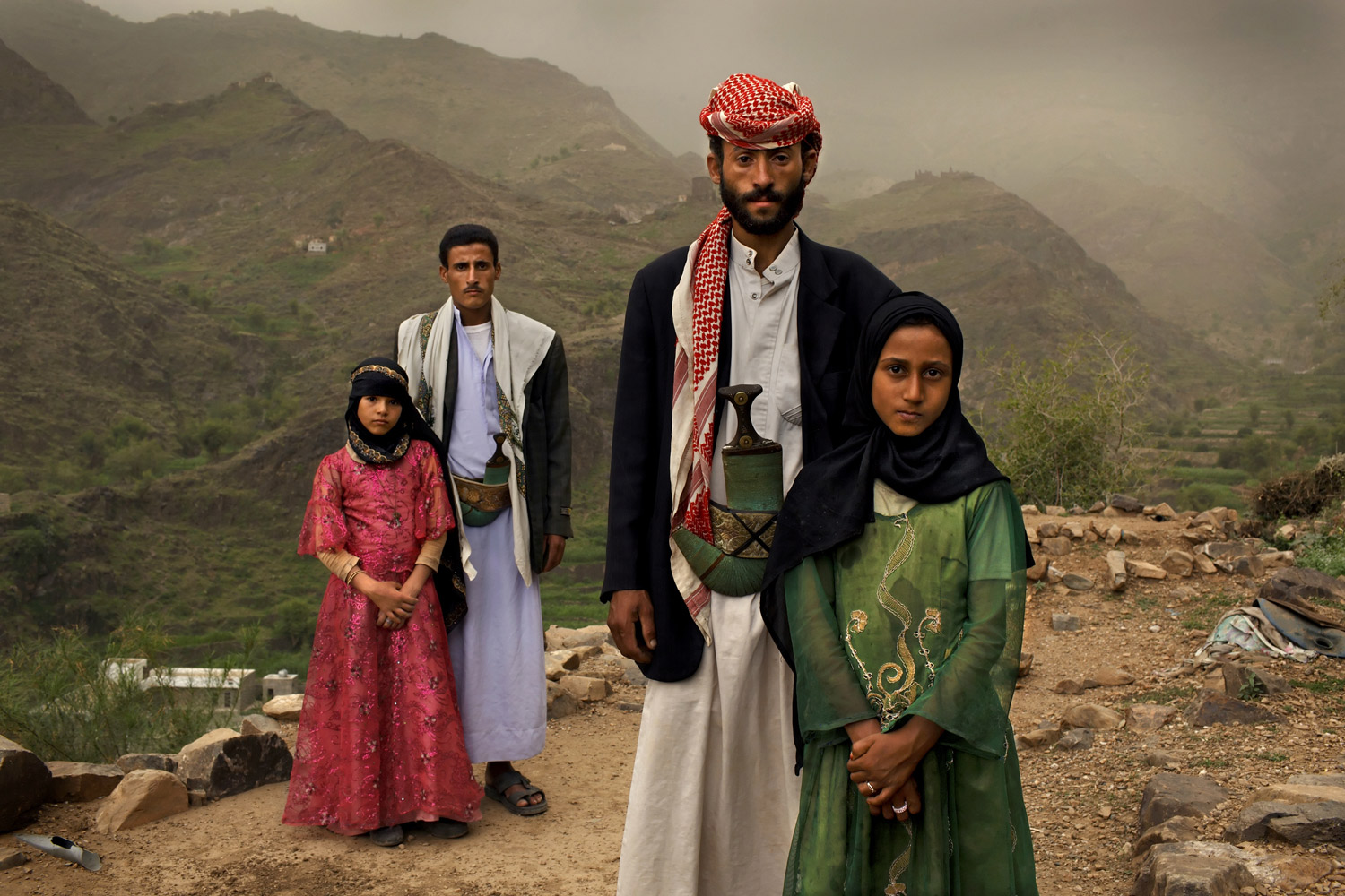 First Prize Contemporary Issues StoriesJune 10, 2010. Hajjah, Yemen. Tahani (in pink), who married her husband Majed when she was 6 and he was 25, poses for this portrait with former classmate Ghada, also a child bride, outside their mountain home in Hajjah. Nearly half of all women in Yemen were married as children. Child marriage is outlawed in many countries and international agreements forbid the practice yet this tradition still spans continents, language, religion and caste.