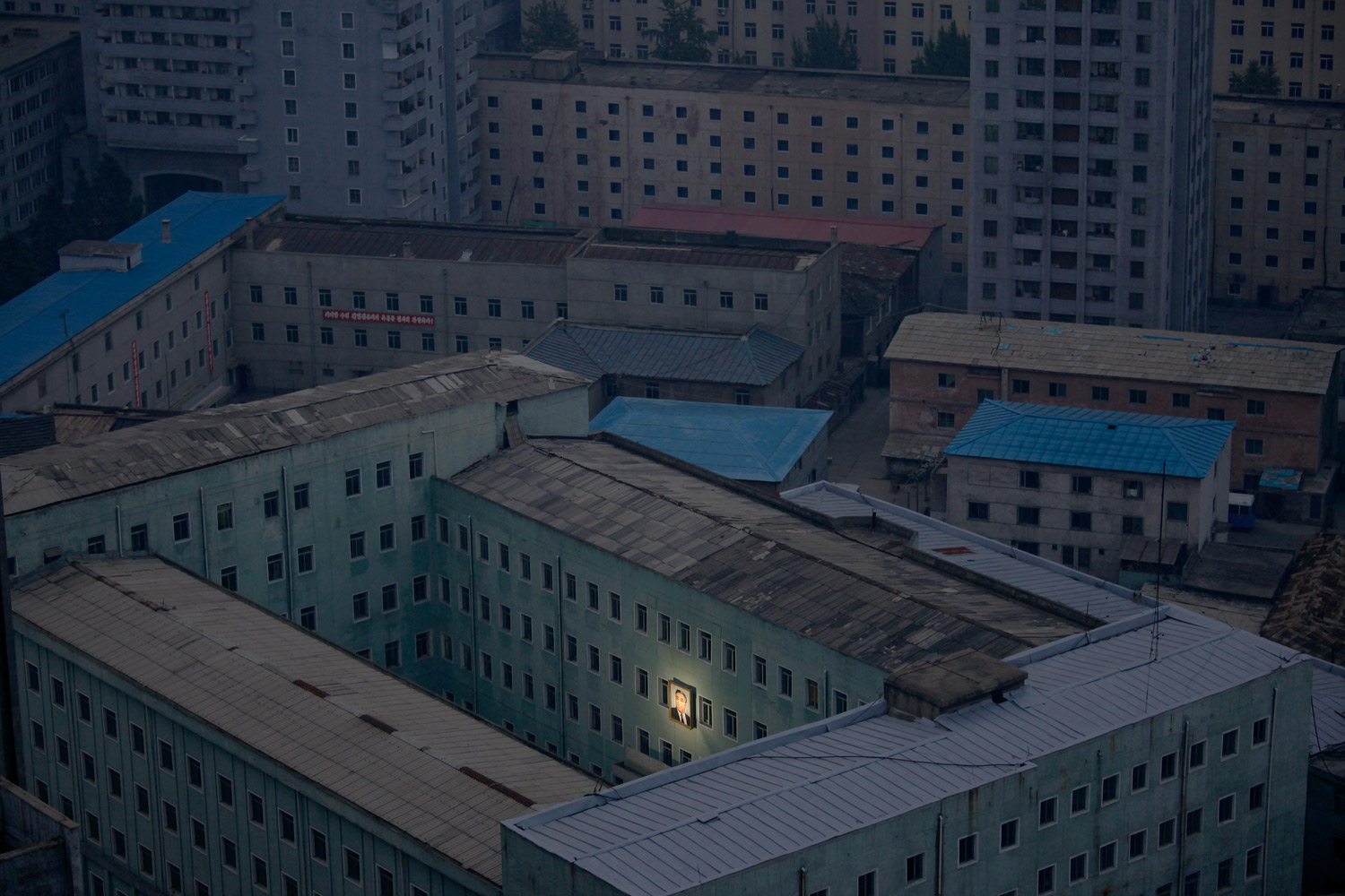First Prize Daily Life SinglesOctober 5. Pyongyang, North Korea.                               A picture of North Korea's founder, Kim Il-sung, decorates a building in the capital Pyongyang.