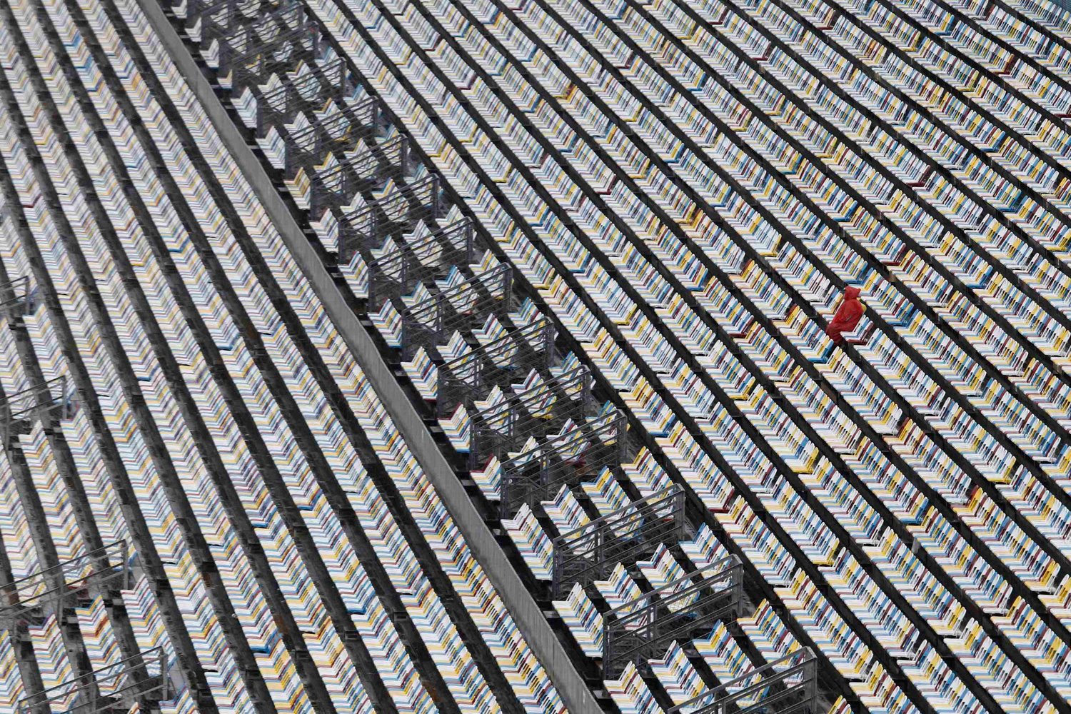 Feb. 27, 2012. A race fan sits surrounded by empty seats in anticipation of the NASCAR Sprint Cup Series 54th Daytona 500 race in Daytona Beach, Fla.
