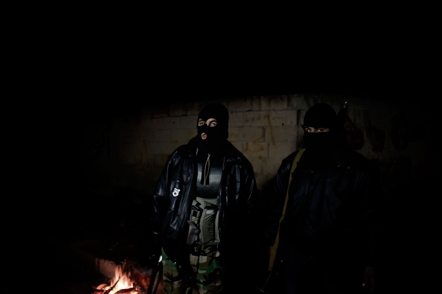 Members of the Free Syrian Army stand guard at night in Al Qsair. Jan. 23, 2012