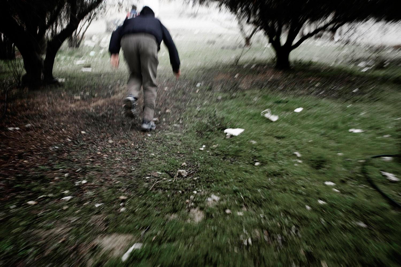 A man runs away from Syrian army snipers in Al Qsair. Jan. 25, 2012