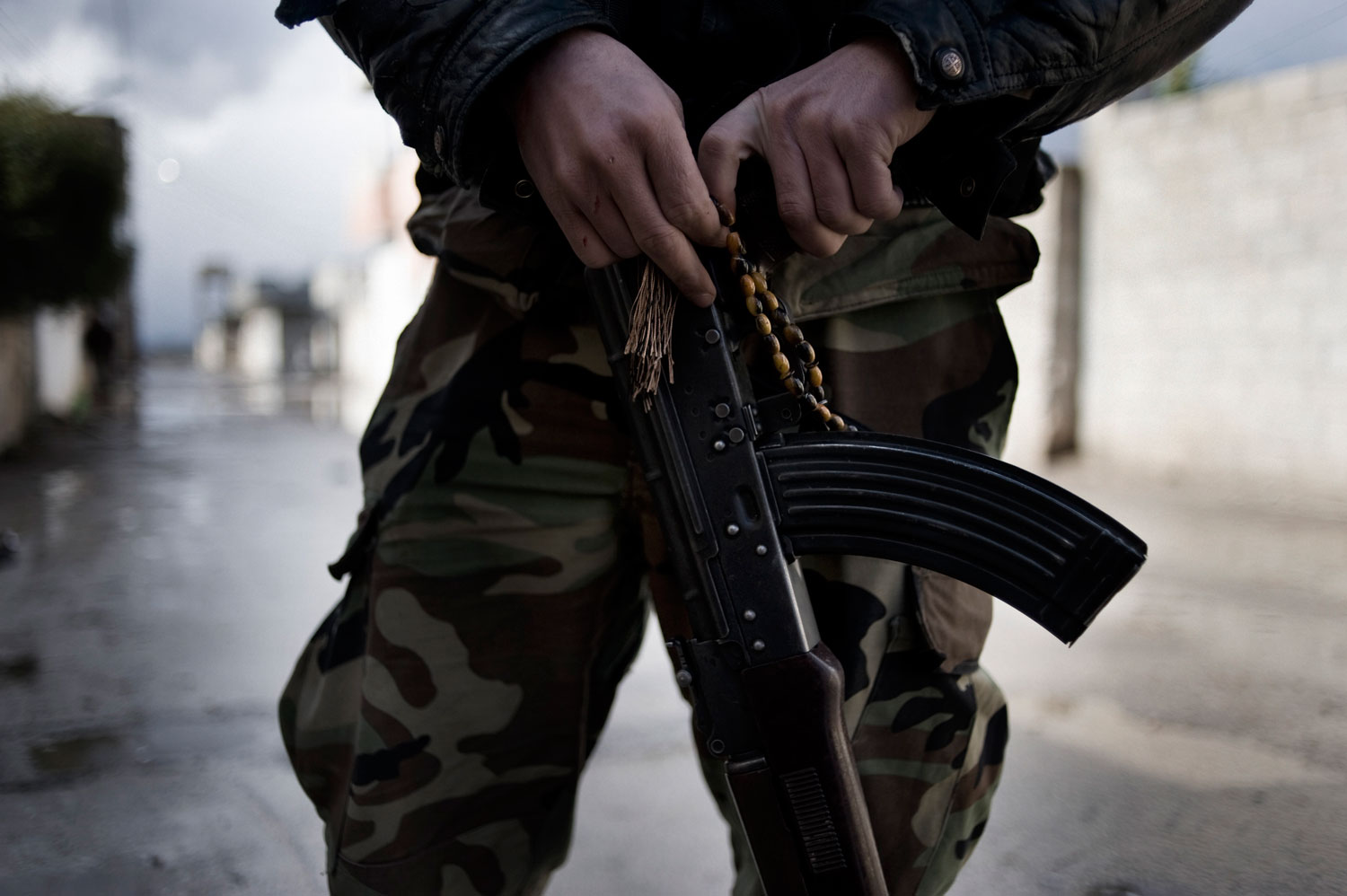 A member of the Free Syrian Army holds an AK-47 in Al Qsair. Jan. 27, 2012
