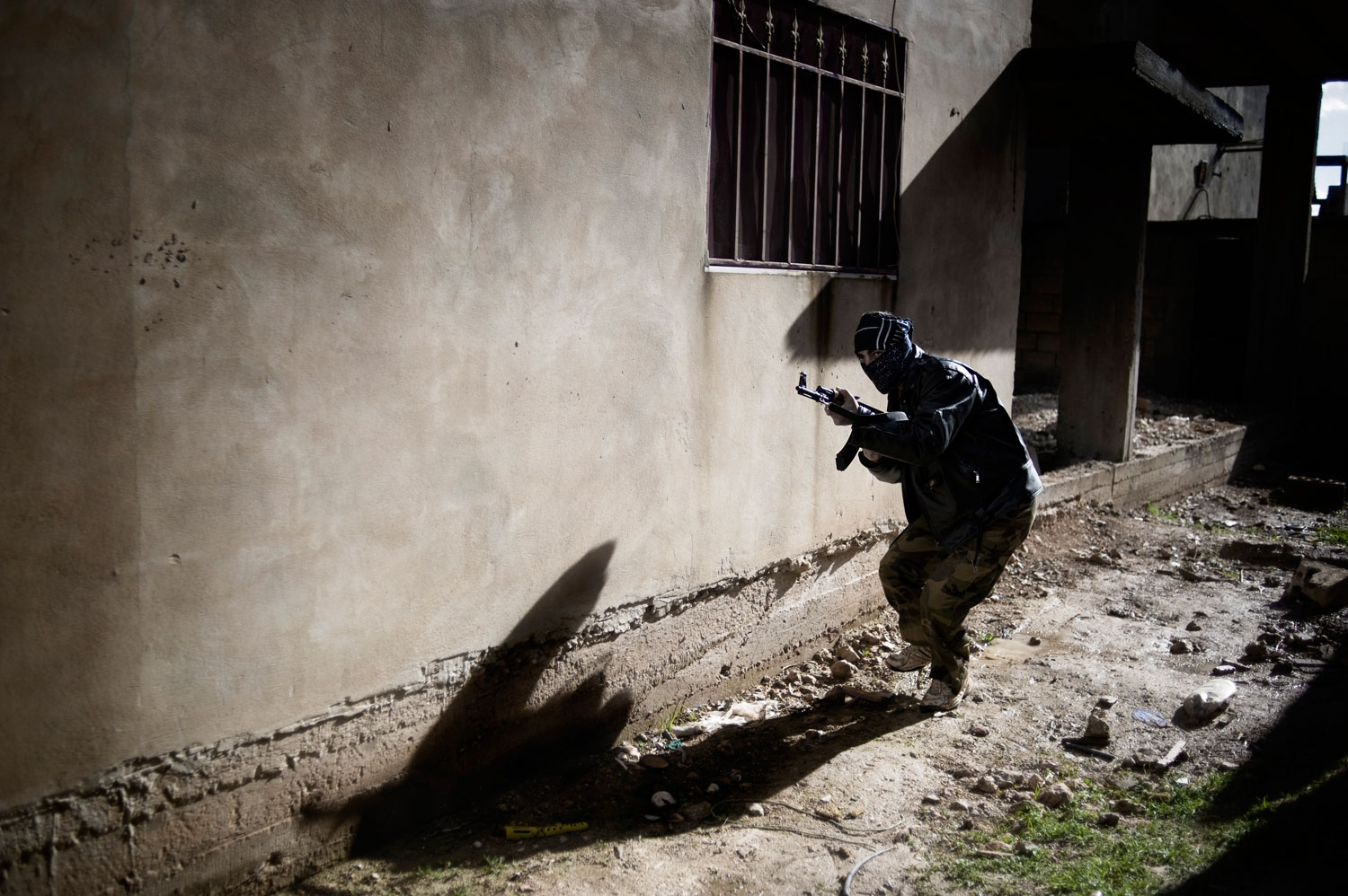 A member of the Free Syrian Army participates in an attack operation against the Syrian army in Al Qsair, a town of 40,000 inhabitants that is southwest of Homs. Jan. 27, 2012