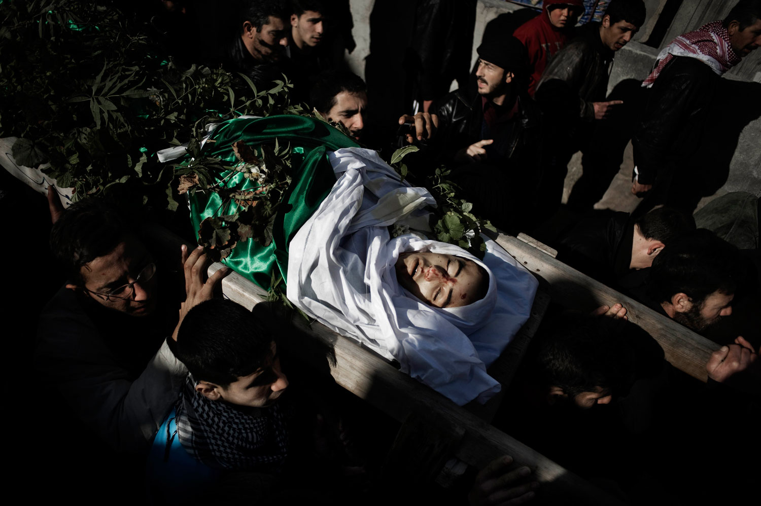 Mourners at the funeral of Mohammad Baakour, a 14-year-old shot dead by a Syrian army sniper in Al Qsair. Jan. 27, 2012
