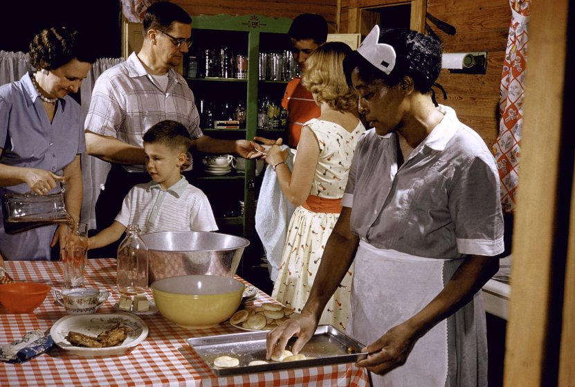 African-American maid prepares a white family's supper in Greenville, SC, 1956.