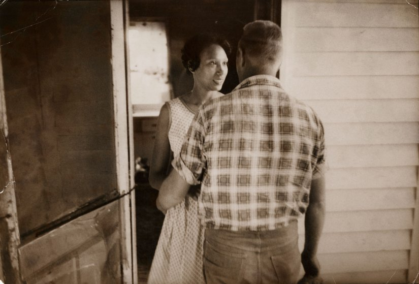 Mildred Loving greets her husband Richard on their front porch, King and Queen County, Virginia, April 1965.